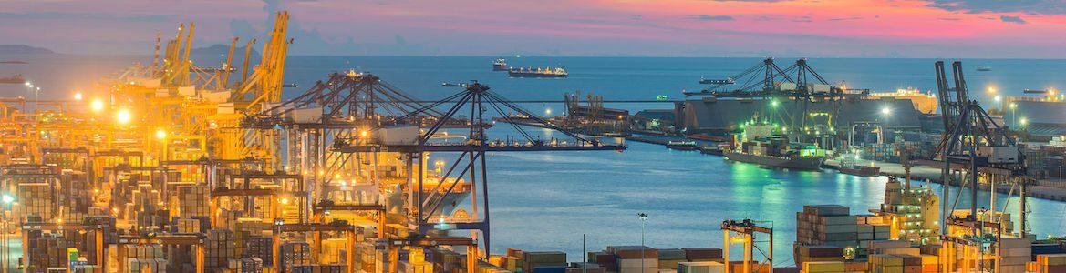 container cargo freight ship cranes bridge in shipyard logistic import export